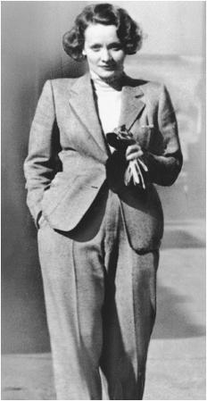 Marlene Dietrich modeling a masculine-styled pant suit designed by