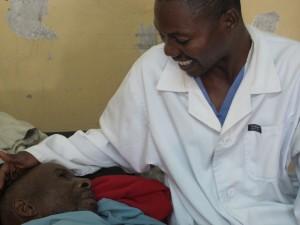 AFRICA Ndemeyi Ndinbiboya with Heal Africa nurse Benjamin Lwevweka Elizabeth Bryant_0