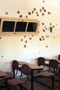 RS32919_Bullet holes in classroom El Jeel Eljaded School